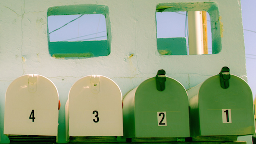 Row of 4 Mailboxes - 2 green and 2 cream